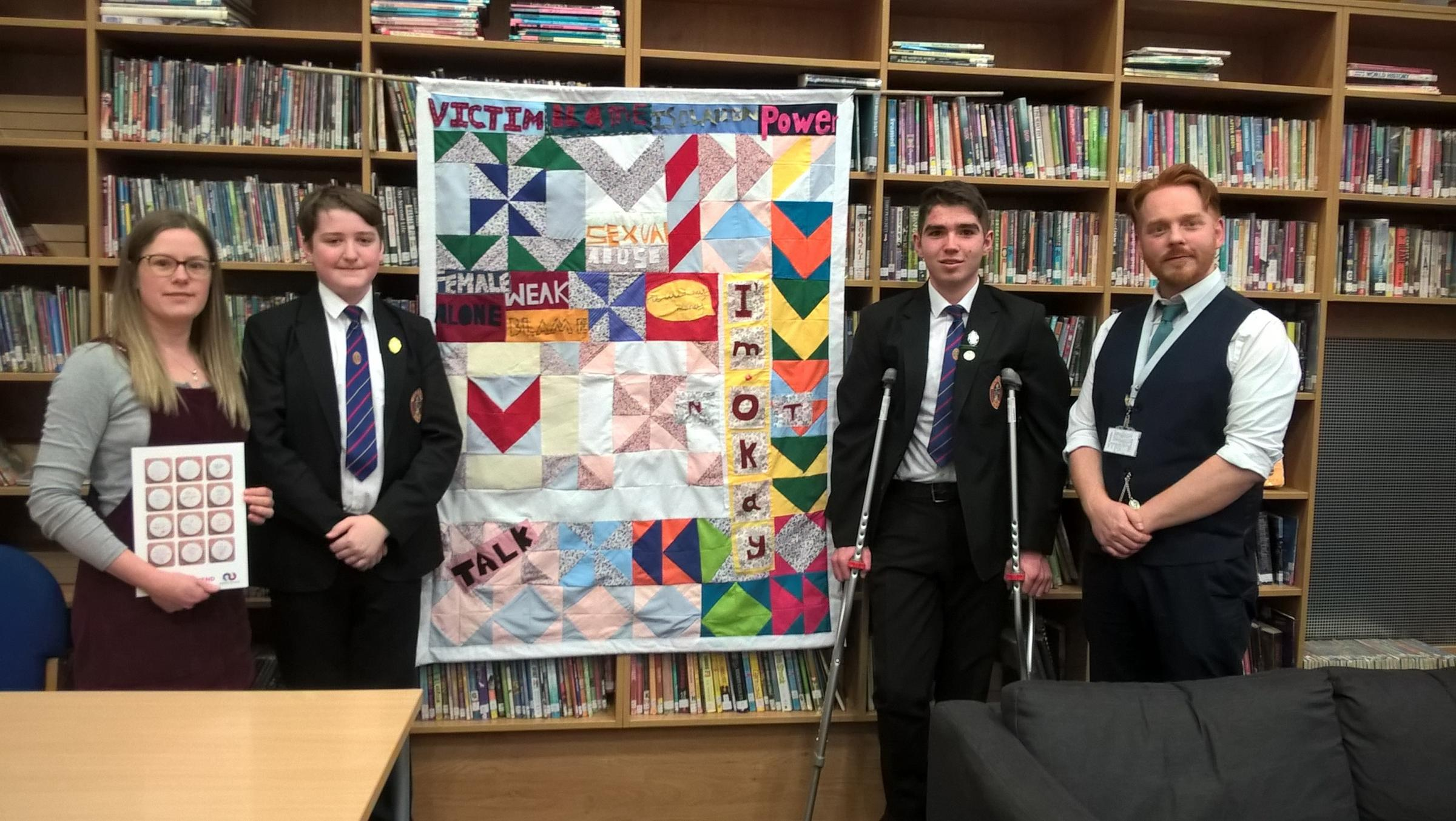 ART: From left, artist Polly Turner with pupils Wesley Herridge and Joseph Kane and teacher Jonny Arnold