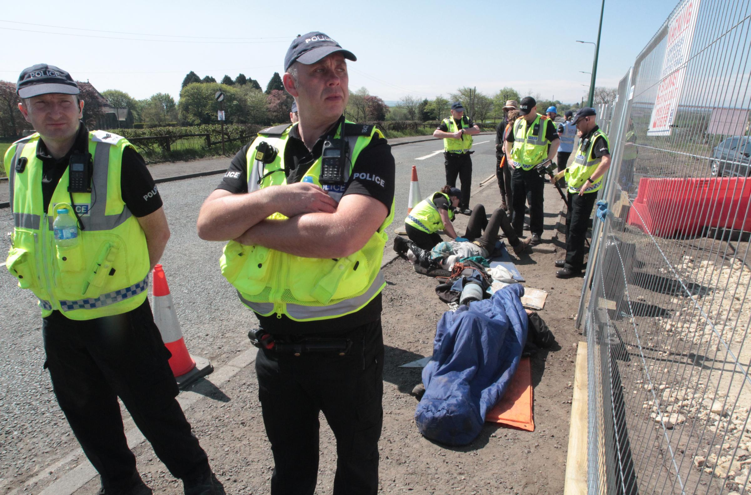 CHAINED: Activists opposed to the creation of an opencast coalmine have chained themselves to a metal tube to prevent workmen making progress Picture: Gavin Engelbrecht