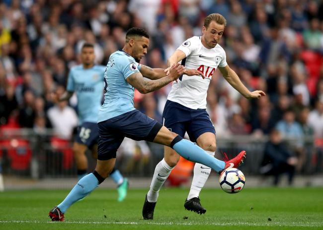 STAYING? Tottenham Hotspur's Harry Kane (right) in a battle with Newcastle United's Jamaal Lascelles, who is interesting Spurs
