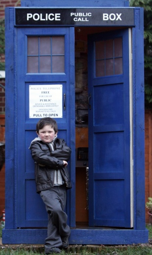 LOST FOR WORDS: Dr Who fan Nathan Taylor, six, with the full-scale replica Tardis  built by his stepfather, Stephen Hudspeth