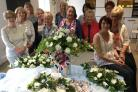 HONOUR: The Greenfield Flower Arranging Group show off their royal display ahead of Prince Harry and Meghan Markle's big day this week