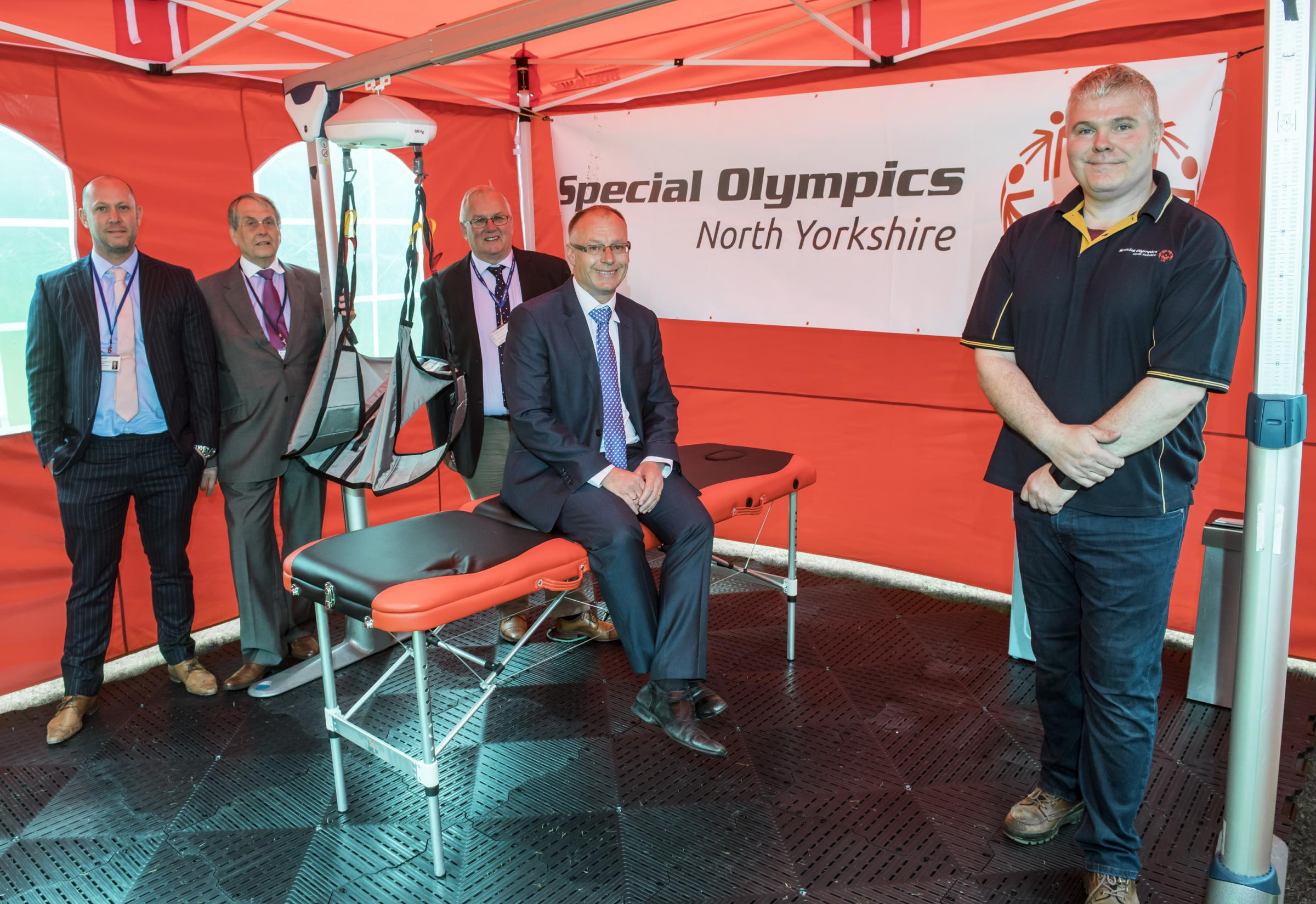 CHANGING: county councillors Callum Walsh, David Chance, Executive Member for Stronger Communities, Bob Baker and Gareth Dadd, Member for Thirsk and Deputy Leader, with Andrew Newton, chairman of Special Olympics North Yorkshire
