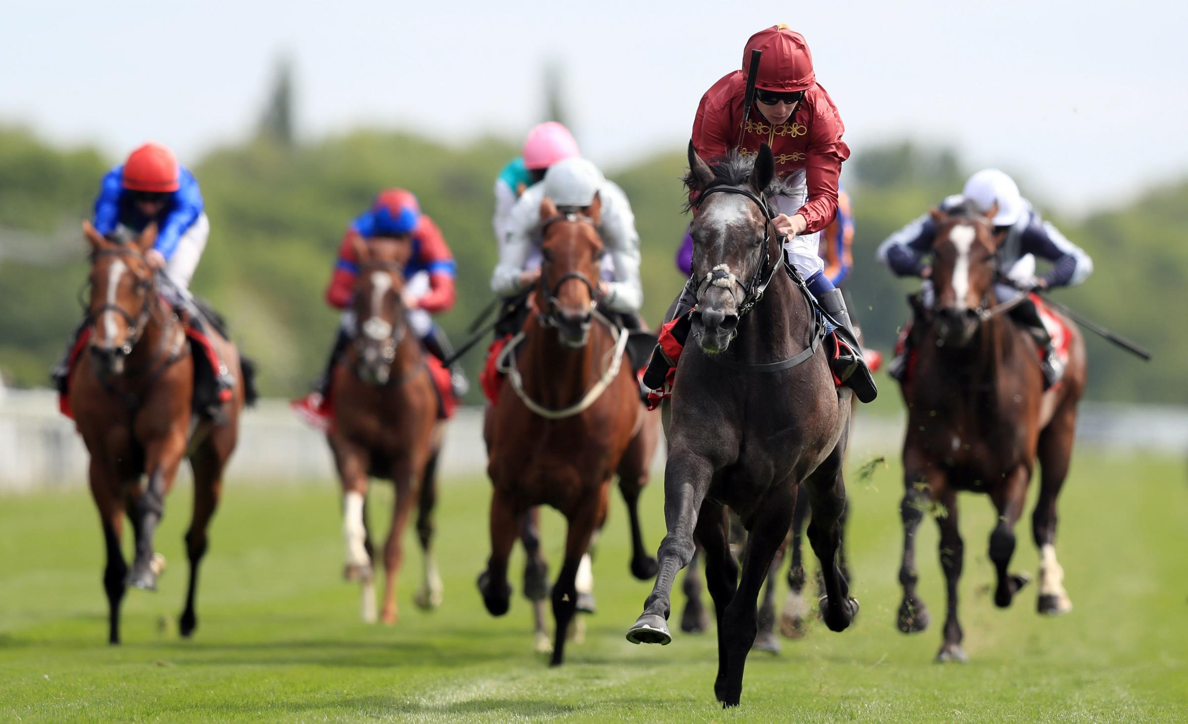 MANE ATTRACTION: Roaring Lion bursts clear to land the Betfred Dante Stakes at York (Picture: Simon Cooper/PA Wire)