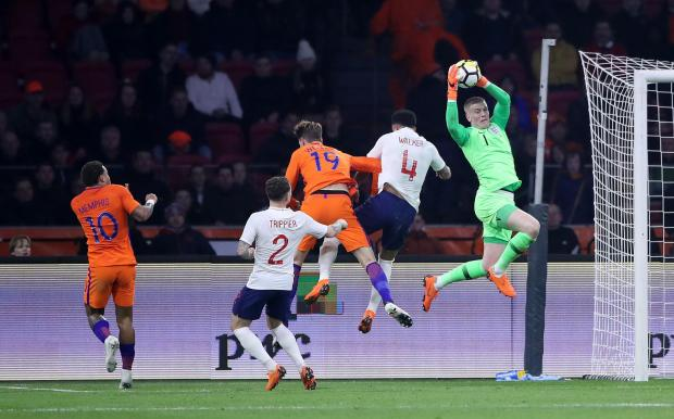 The Northern Echo: CONFIDENT CHARACTER: Jordan Pickford claims a cross for England in a friendly against Holland in Amsterdam; below, he makes a flying save to deny Swindon at Valley Parade during his loan with City