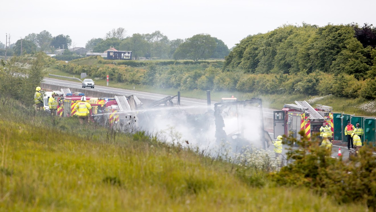 Fire crews at the scene of a serious accident on the A1 involving a car transporter and a lorry. Picture: Stuart Boulton