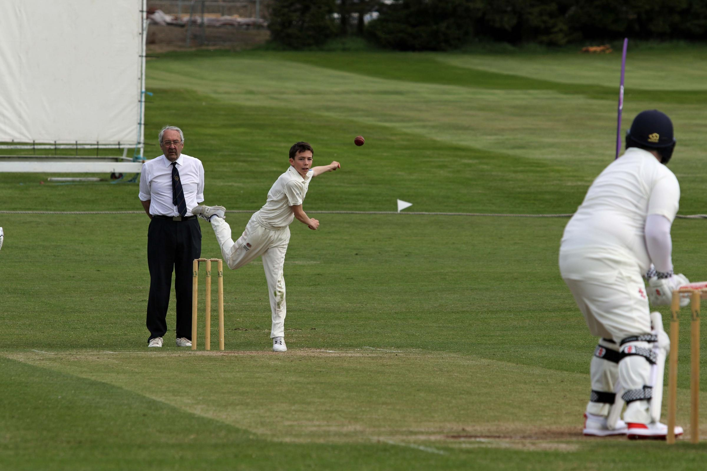 BOWL: Barnard Castle School spin bowler Theo Truss in action