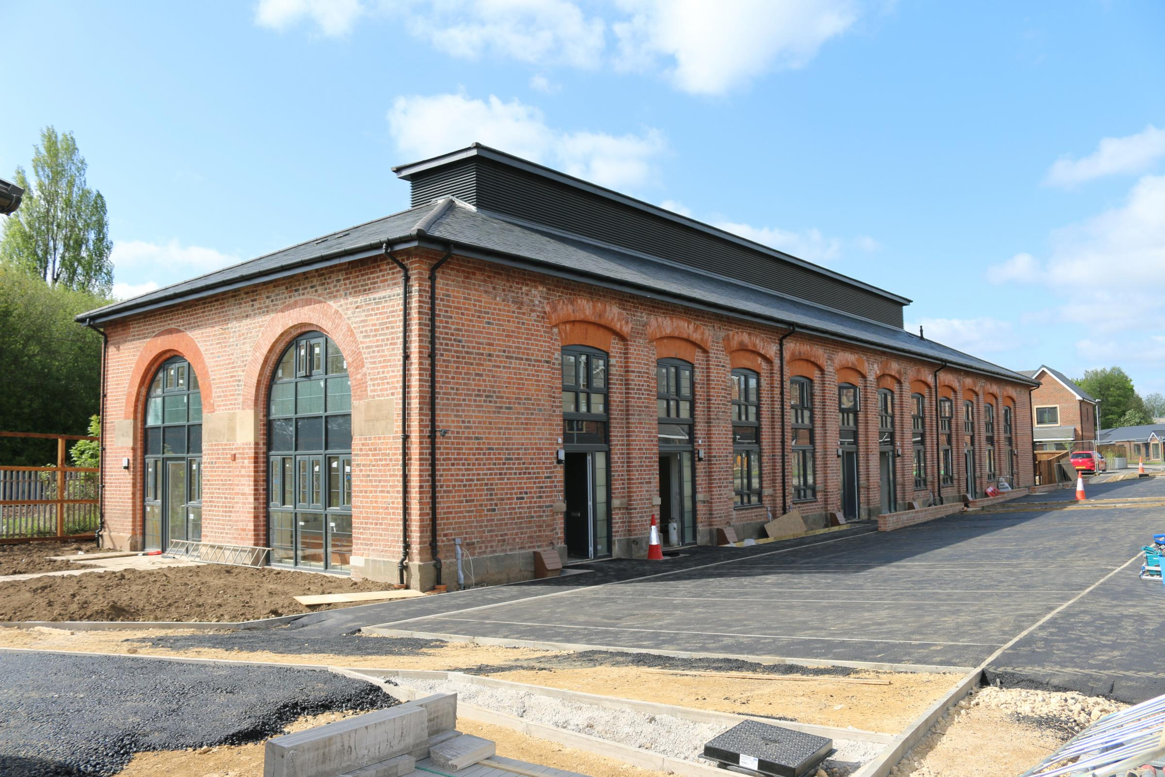 SOCIAL HOUSING: The restored Haughton Road engine shed, as seen this week, as it nears the end of its conversion. The housing on top of the roof is a clerestory - a ventilator that let the steam and smoke from the engines escape