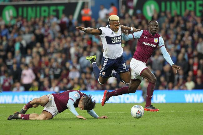 Adama Traore of Middlesbrough battles with Albert Adomah & Jack Grealish during the Sky Bet Championship play off semi final 2nd leg match between Aston Villa and Middlesbrough at Villa Park, Birmingham on Tuesday 15th May 2018. (Credit: Mark Fletcher | M