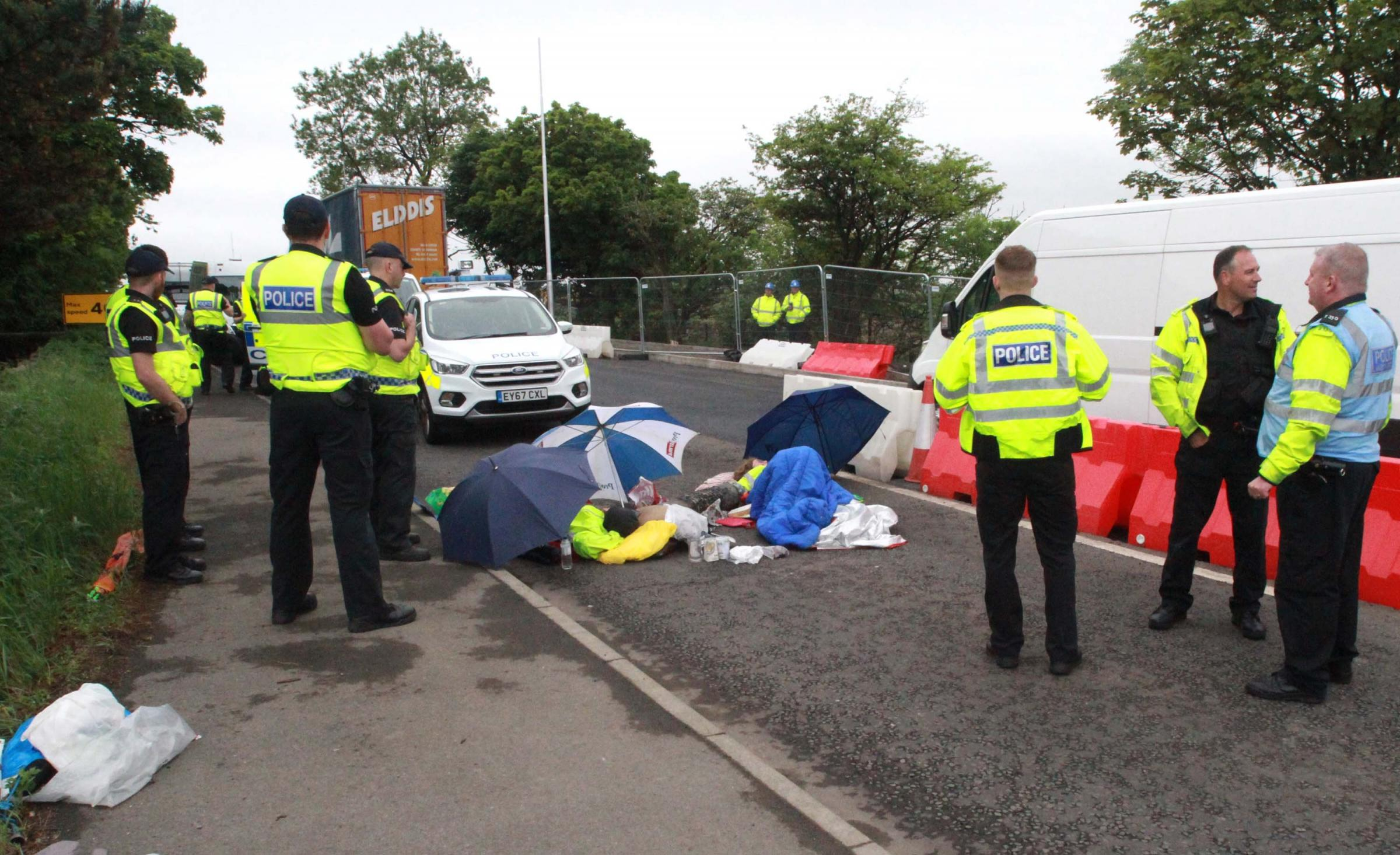 BLOCKADE: Activists with the Campaign to Protect Pont Valley 'locked-on' to to prevent resurfacing of road outside Bradley opencast mine site between Leadgate and Dipton Picture: Gavin Engelbrecht