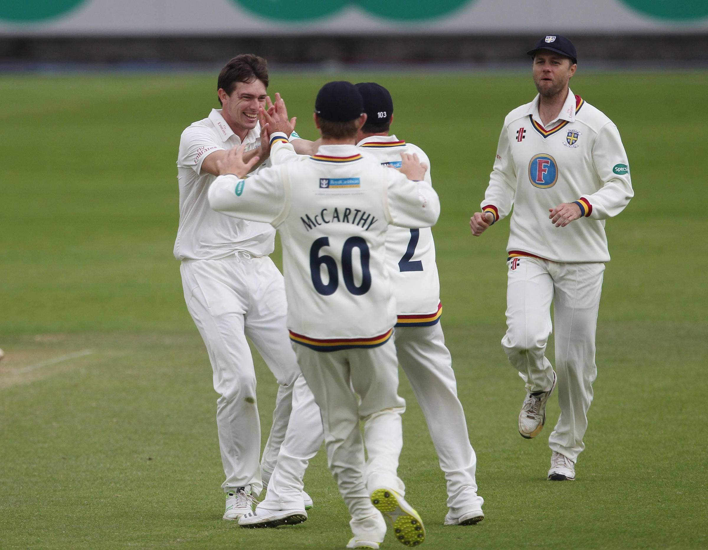 Durham's Matt Salisbury celebrates with his team mates after claiming the wicket of Wayne Madsen during the third day of the Specsavers County Championship match between Durham County Cricket Club and Derbyshire County Cricket Club at Emirates Riversi