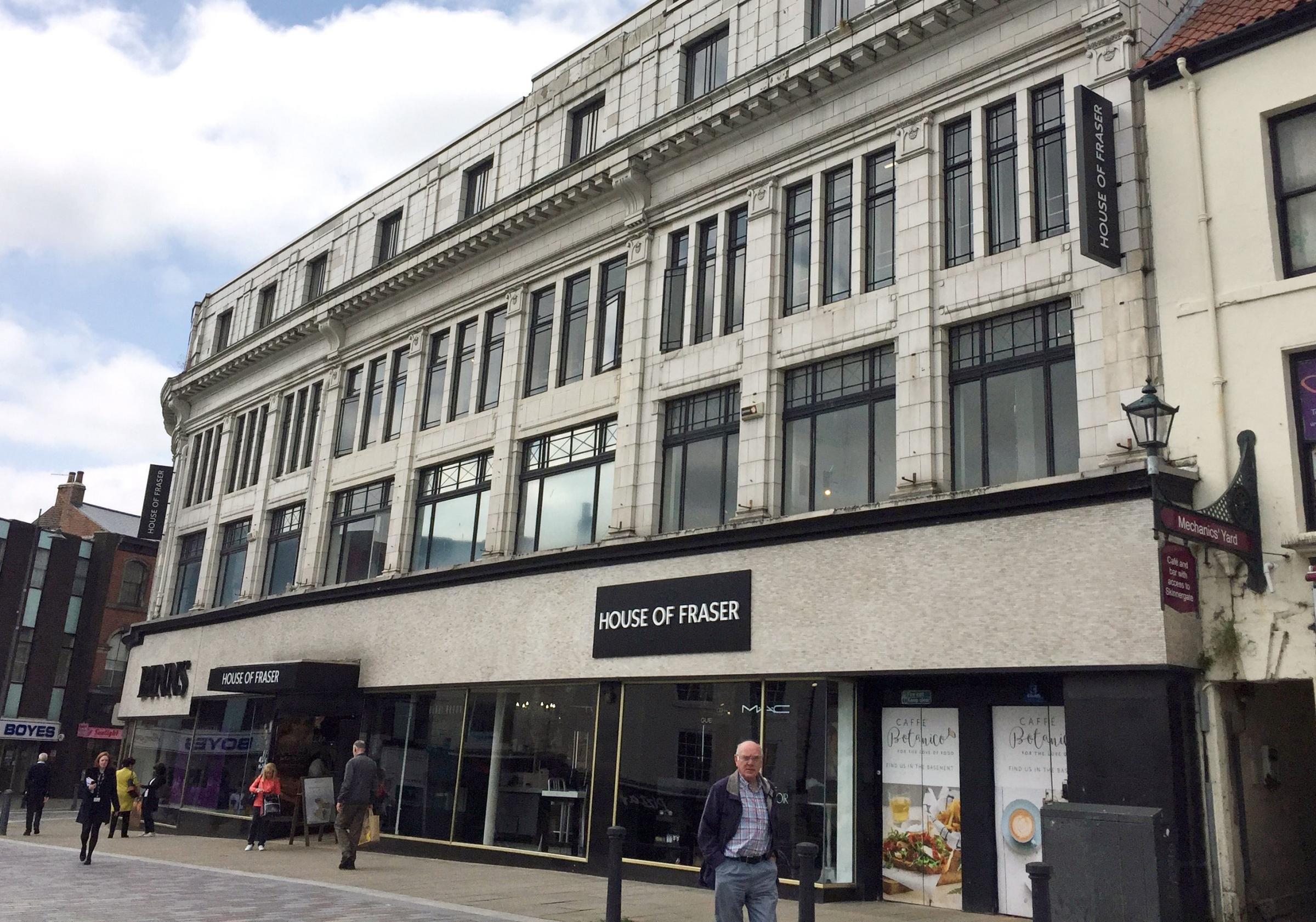 Pedestrians pass the Darlington branch of House of Fraser, which is one of those expected to close after the retailer announced plans to shut 31 of its 59 stores across the UK and Ireland as part of a rescue deal, impacting around 6,000 jobs. Picture: Tom