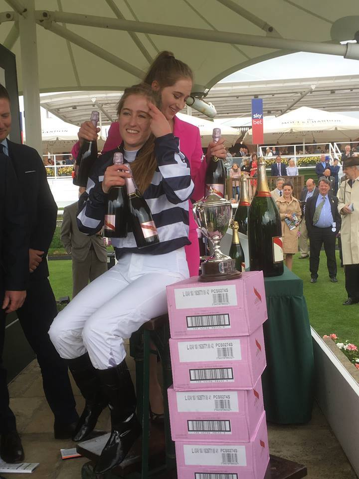 BUBBLING OVER: Sophie Dods and her twin sister, Chloe, receive their weight in champagne after Mister Belvedere's victory at York