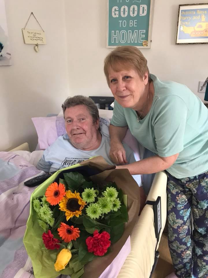 DEVOTED: Christine Cunningham and her husband, Adrian, with the flowers they received from Dale Care. The home care provider wanted to celebrate the family members of their clients who devote their lives to care