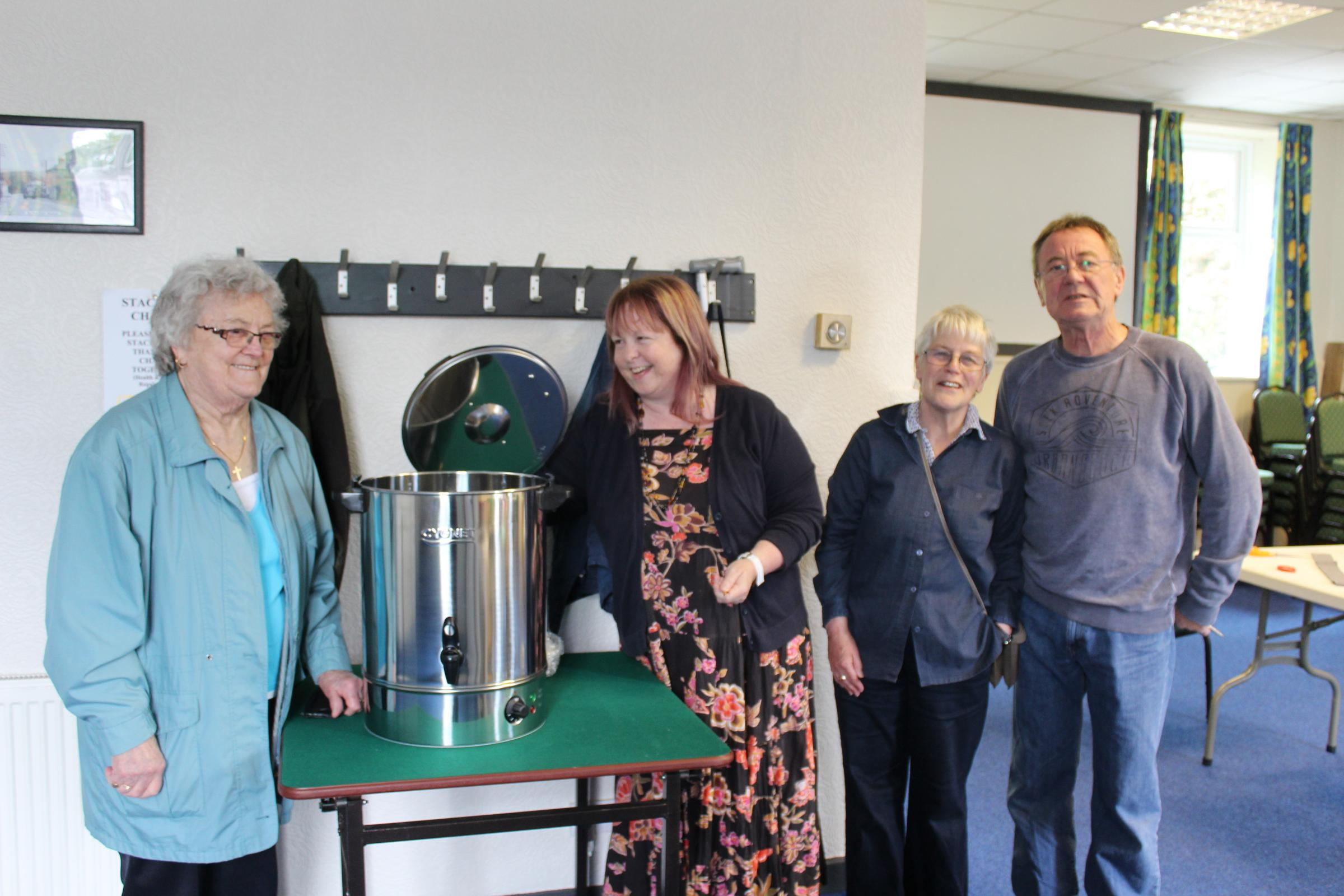 GRANT: From left, Vera Brown, Val Greenbank Margot Lunnon and Steve Peters with the new boiler