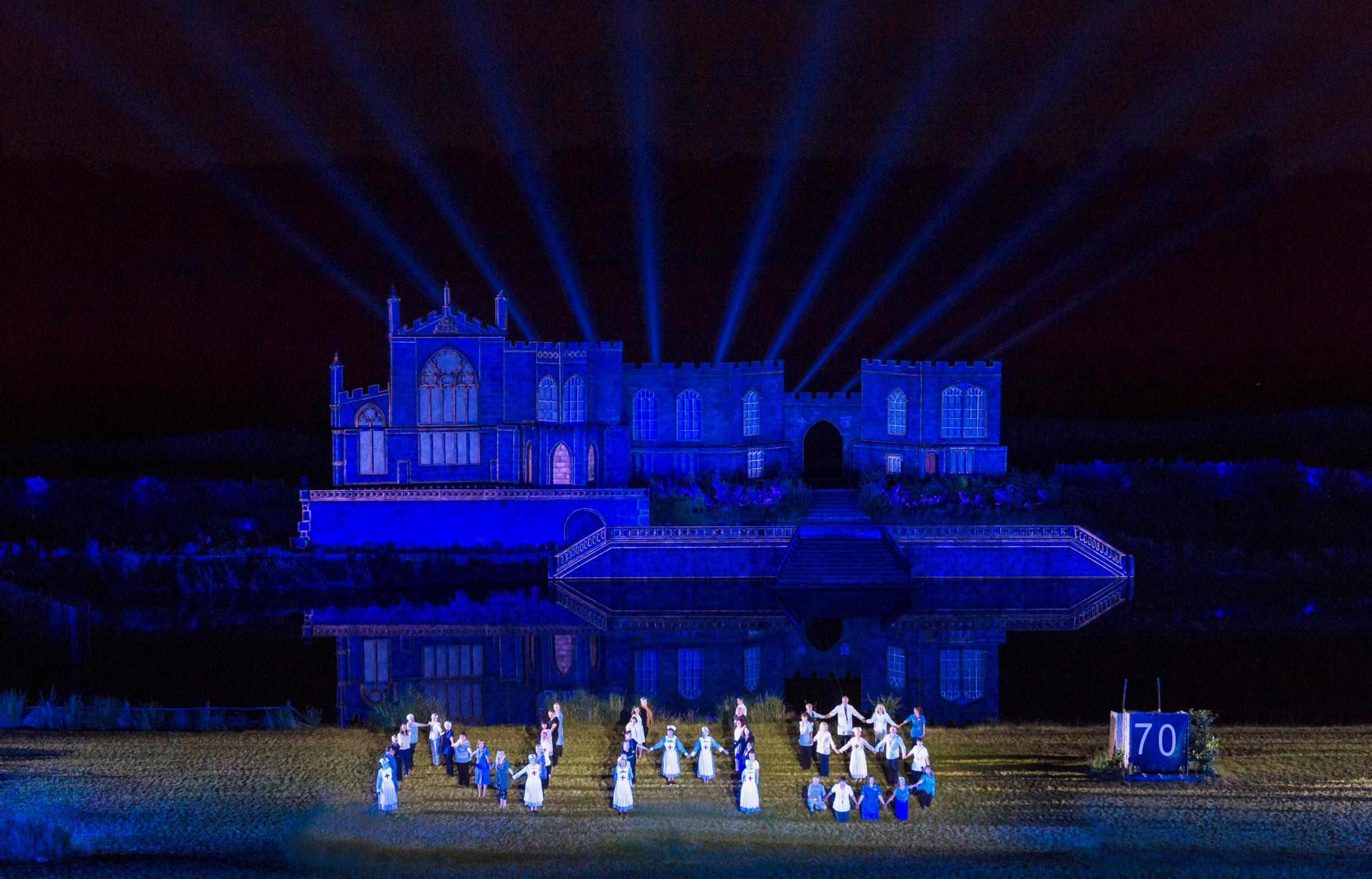 CAST: NHS staff past and present, who volunteer at Kynren in Bishop Auckland, mark the anniversary Picture: PETER HAYGARTH