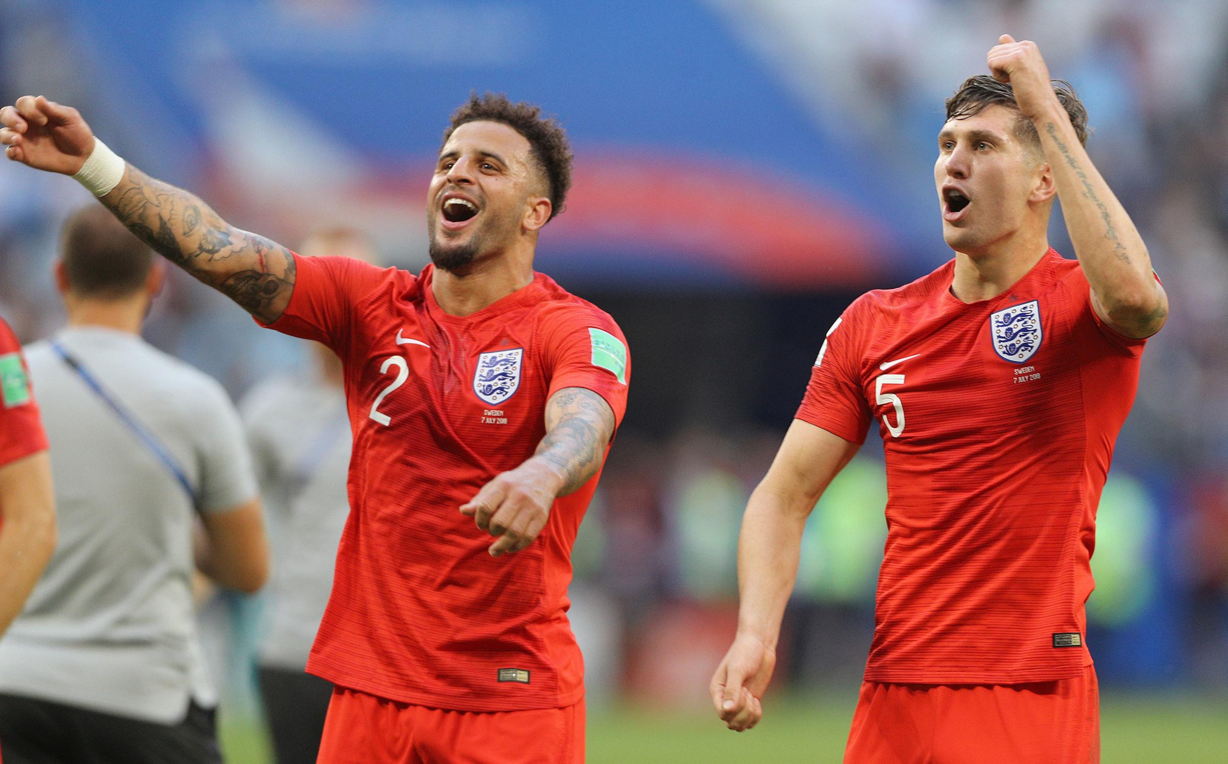England's Kyle Walker and John Stones (right) celebrate victory after the FIFA World Cup, Quarter Final match on Saturday. Picture: PA