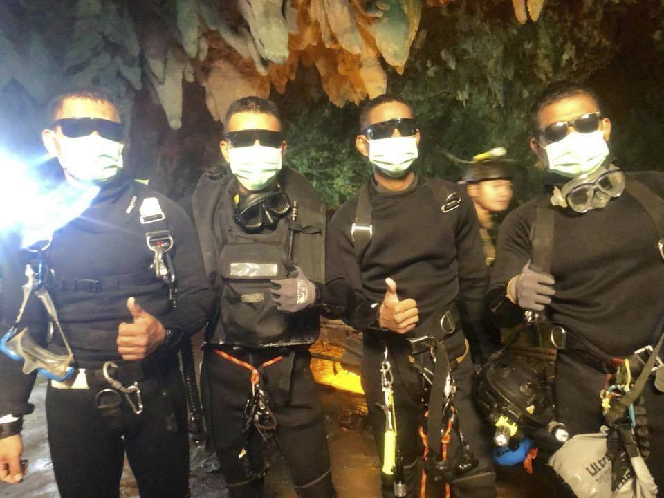 BRAVERY: The last four Thai Navy SEALs come out safely after completing the rescued mission inside a cave where 12 boys and their soccer coach have been trapped since June 23 Picture: ROYAL THAI NAVY VIA AP