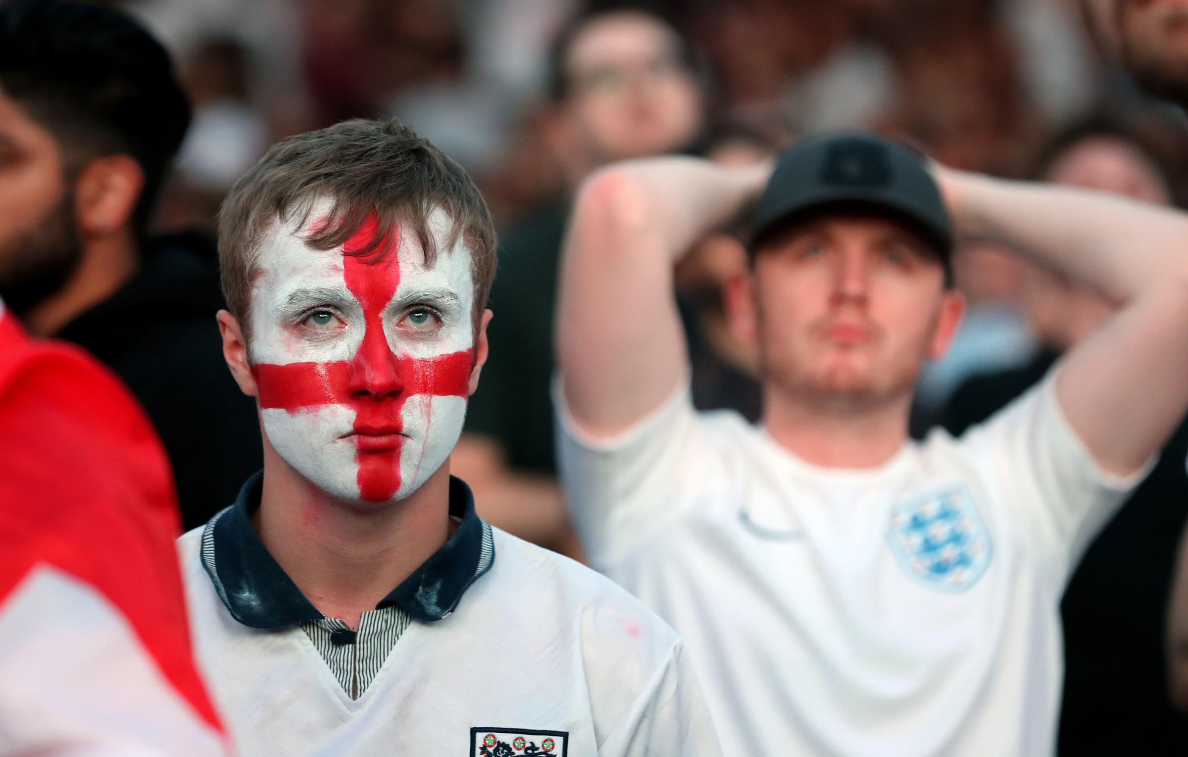 Fans are dejected following England's loss to Croatia. Picture: PA