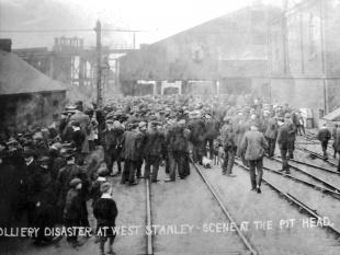 WAITING FOR NEWS: The scene at the pithead after the explosion. Below, crowds turn out for one of the funeral processions