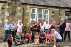 COMMUNITY: The community in Thornley, Weardale, came together to see the 20th defibrillator installed