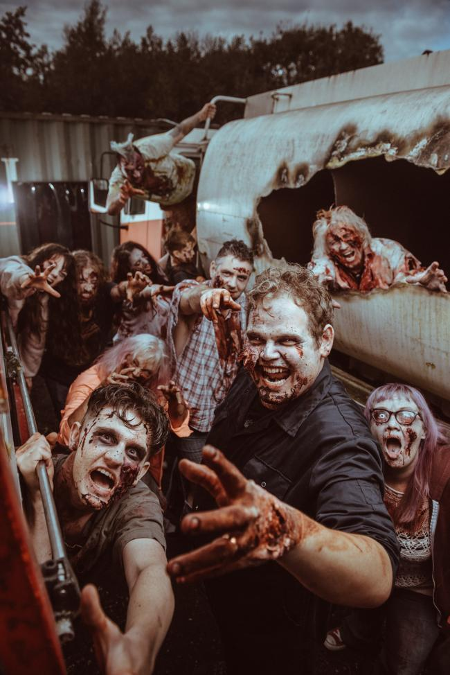 GRUESOME:  A swarm of zombie extras storm the Environment Agency building at Clifton Moor in York