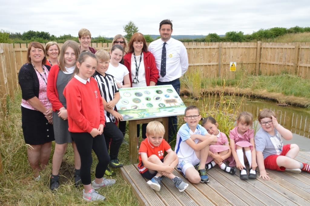 NATURE: (l-r) Jacqueline Robinson, secretary Trina Hodgson, parent helper Louise Jobson, governor Joyce Roberts, headteacher June Lee and Lewis Stokes of The Banks Group at the new dipping pond at Roseberry School