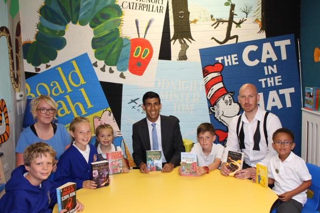 LITERATURE: Rishi Sunak, centre, with pupils and headteacher Matthew Kelly, second right, and deputy headteacher Emily Hopkin, second left