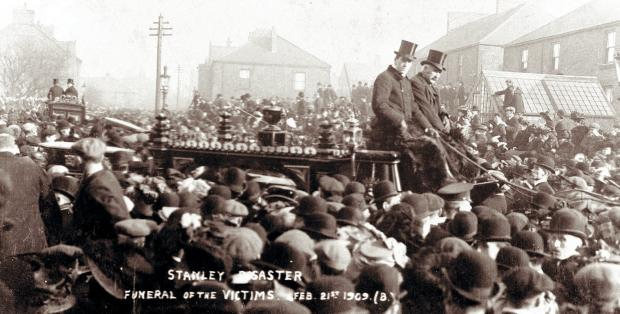 CROWDS TURN OUT: One of the many funerals takes place in Stanley for the pit disaster victims. Thousands of people turned out to watch and pay their r