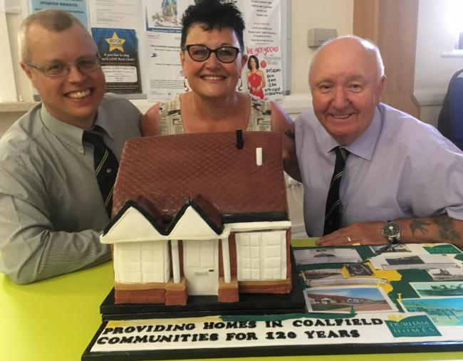 NICE SLICE: Sue and the cake with Durham Aged Mineworkers' Homes boss Paul Mullis, left, and president Gordon Parkin