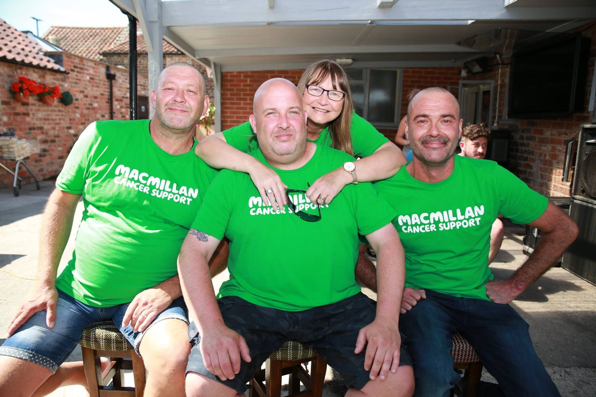 SHAVE: Stephen Claxton, Steve Moss and Darren Plant had their heads shaved. With Wendy Claxton