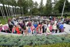 People visit the Omagh Memorial Garden after attending the ceremony for victims