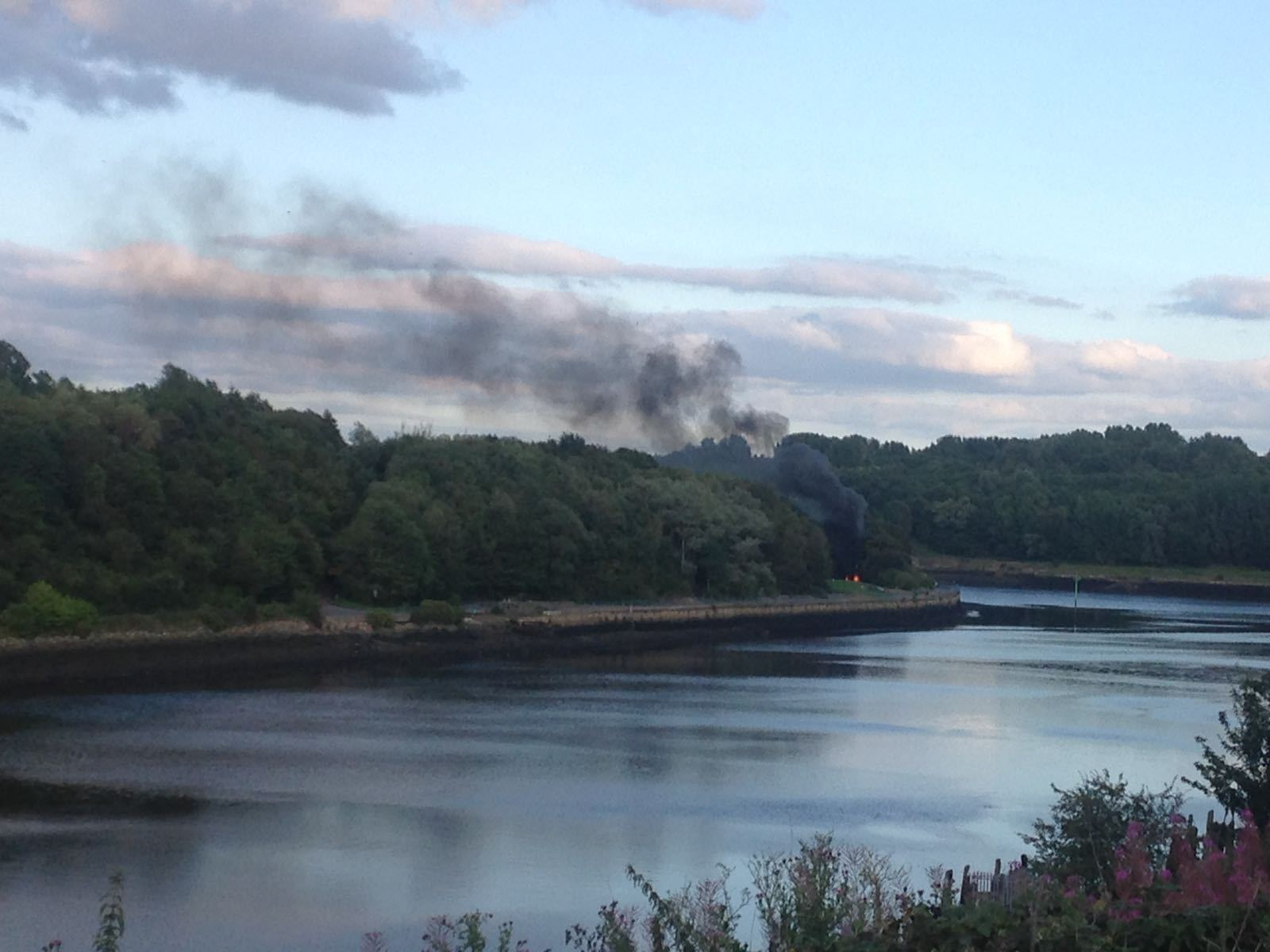 FIRE: Smoke billowing from the flaming car on the banks of the River Tyne in the Walker area of Newcastle Picture: GAVIN ENGELBRECHT