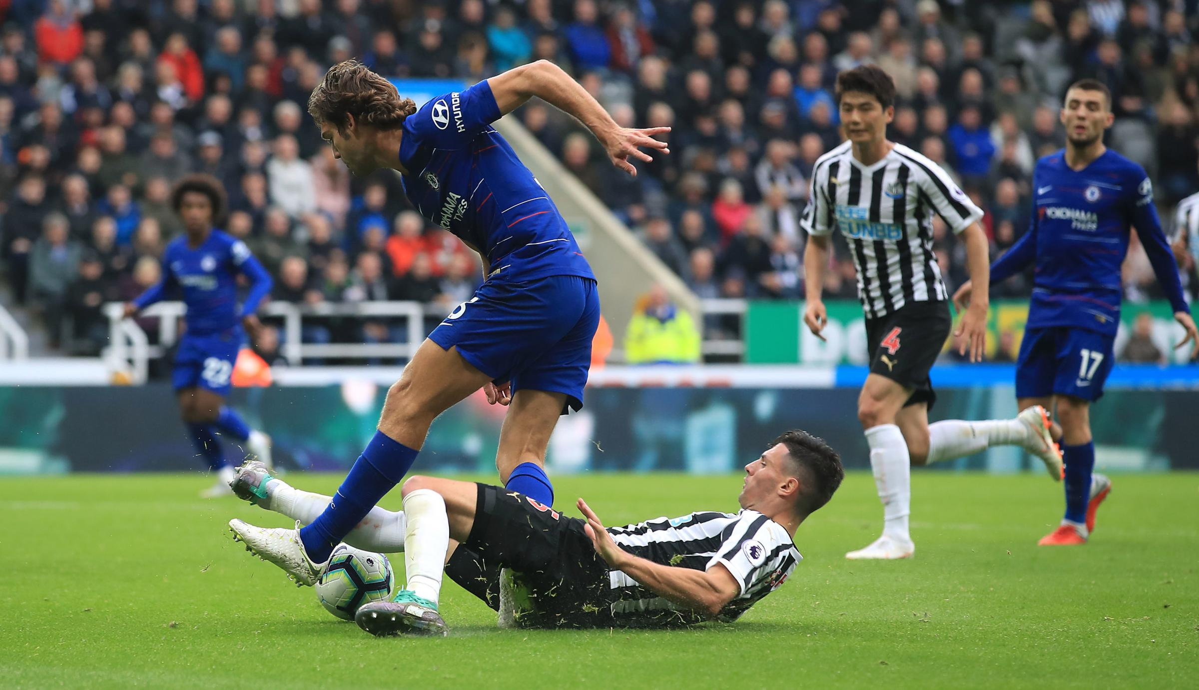 Newcastle United's Fabian Schar (bottom) is seen to have fouled Chelsea's Marcos Alonso during the Premier League match at St James' Park, Newcastle. PRESS ASSOCIATION Photo. Picture date: Sunday August 26, 2018. See PA story SOCCER Newcastle.