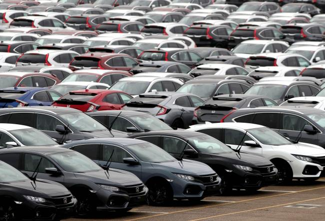 New cars lined up. Demand for new cars rose in August. Picture: PA