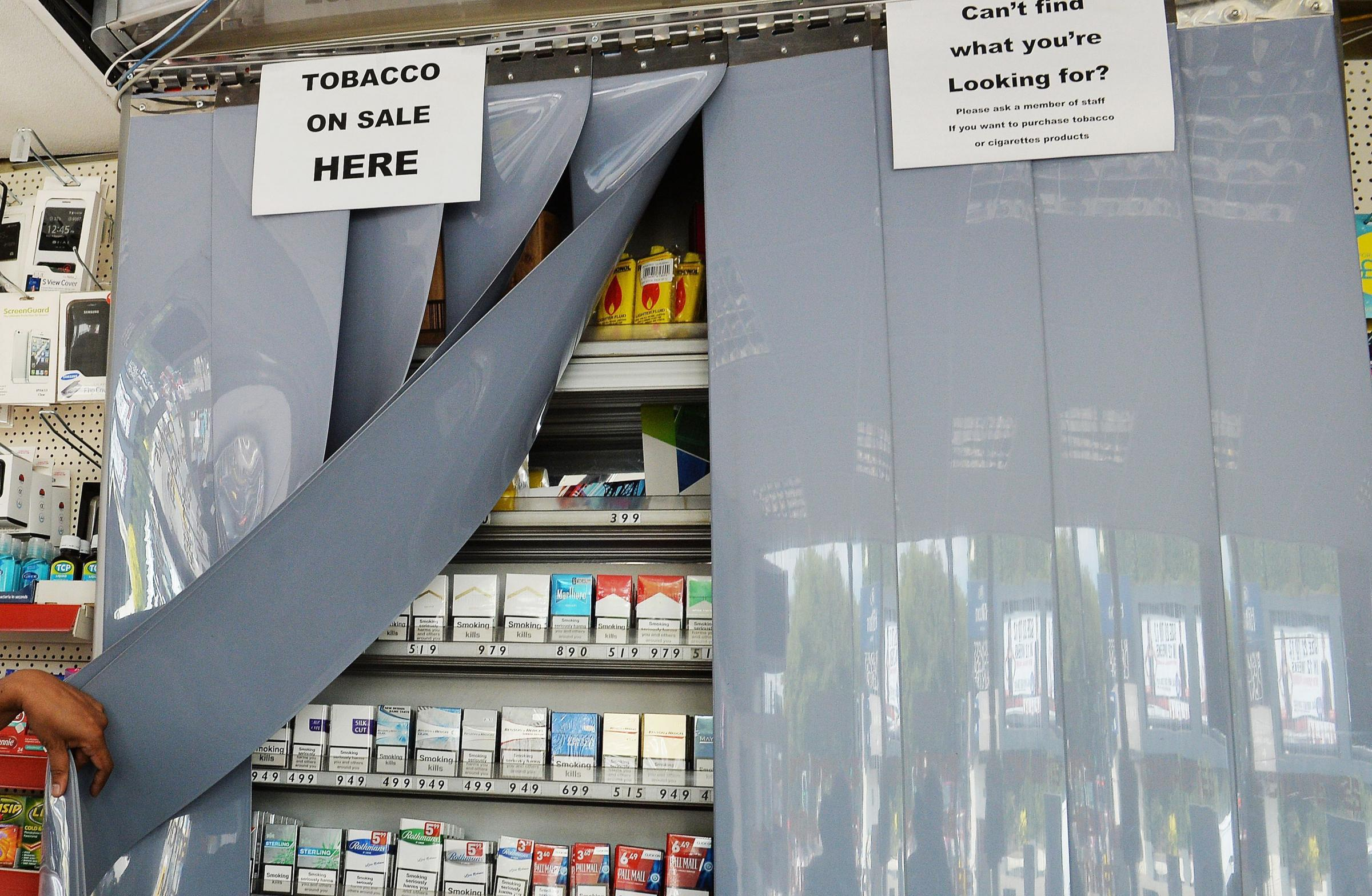 A newsagent and tobacconist shop in London, with the screens that cover all tobacco products, as an investigation has found nearly one in five shops illegally sold cigarettes to children..