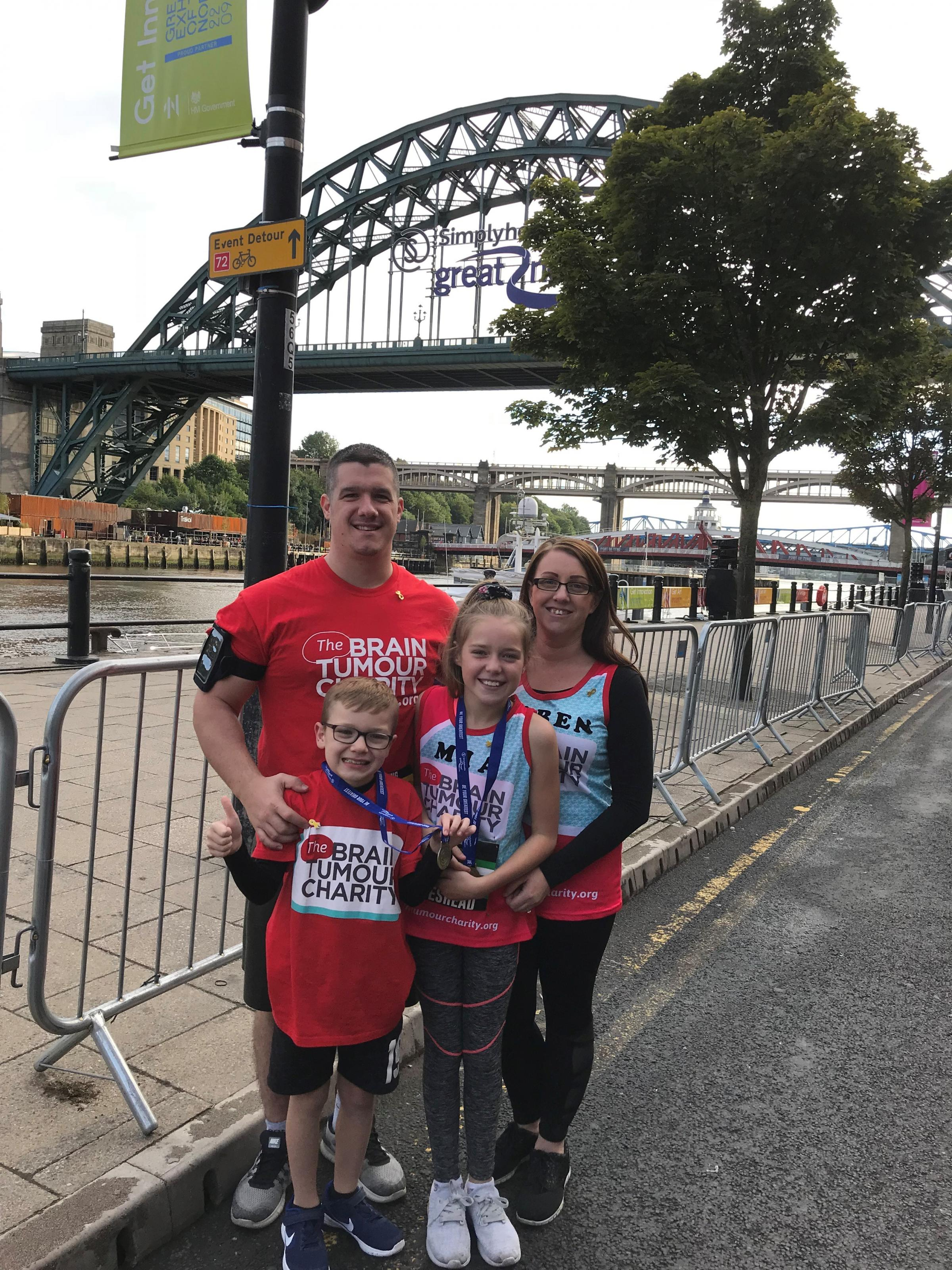 RUN: Aston Sullivan, with his sister, Mia, mum Karen and dad, Thomas Sullivan, in Newcastle after taking part in the Mini Great North Run on Saturday in aid of The Brain Tumour Charity.