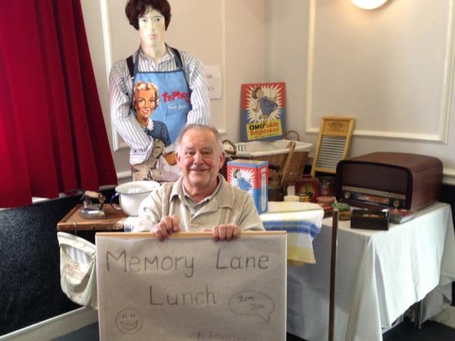 A display of memorabilia and photographs at a Memory Lane Lunch
