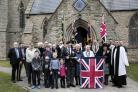 DEDICATED: Spennymoor's new Union Flag with members of the congregation after the blessing ceremony at St Paul's Church Picture: STUART BOULTON