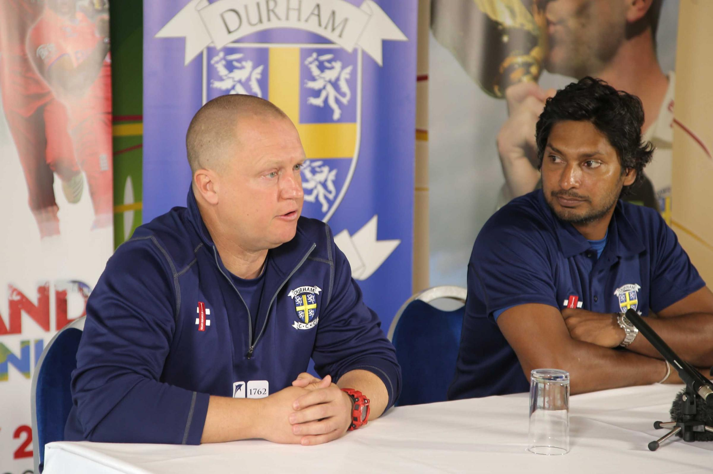 Kumar Sangakkara, right, the new signing for Durham Cricket team pictured at Chester-le-Street pictured at the press conference with coach Jon Lewis..Pic: Andy Lamb 30.04.14.