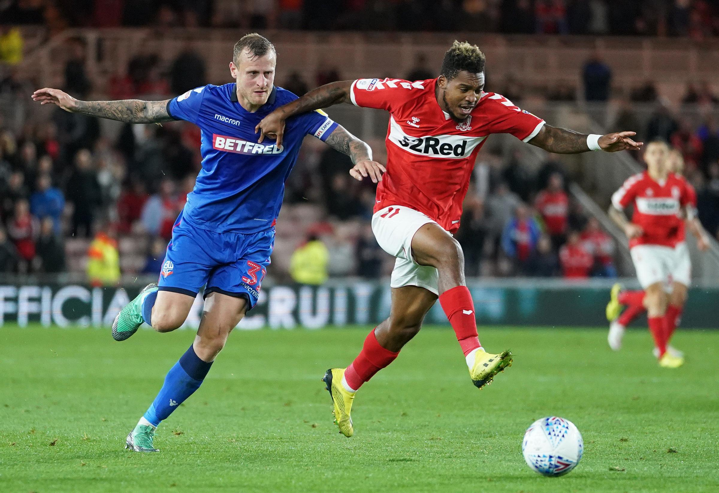ON THE ATTACK: Britt Assombalonga breaks clear of David Wheater during Middlesbrough's 2-0 win over Bolton (Picture: Owen Humphreys/PA Wire)