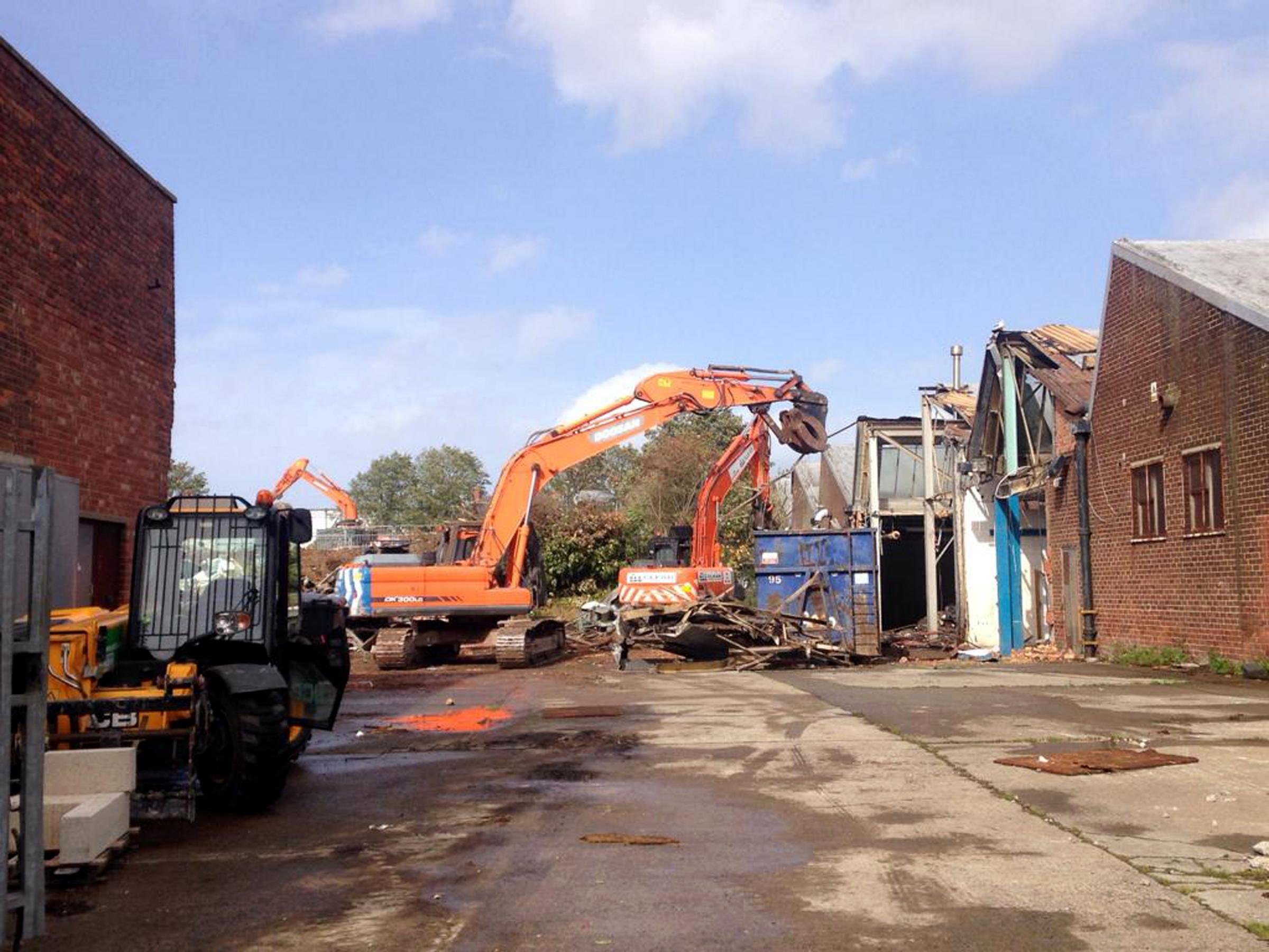 DEMOLISH: Work has started to knock down warehouses ahead of the building of a new retail park, which will include a Lidl supermarket and The Range                                                                               Picture: GAVIN ENGELBRECHT