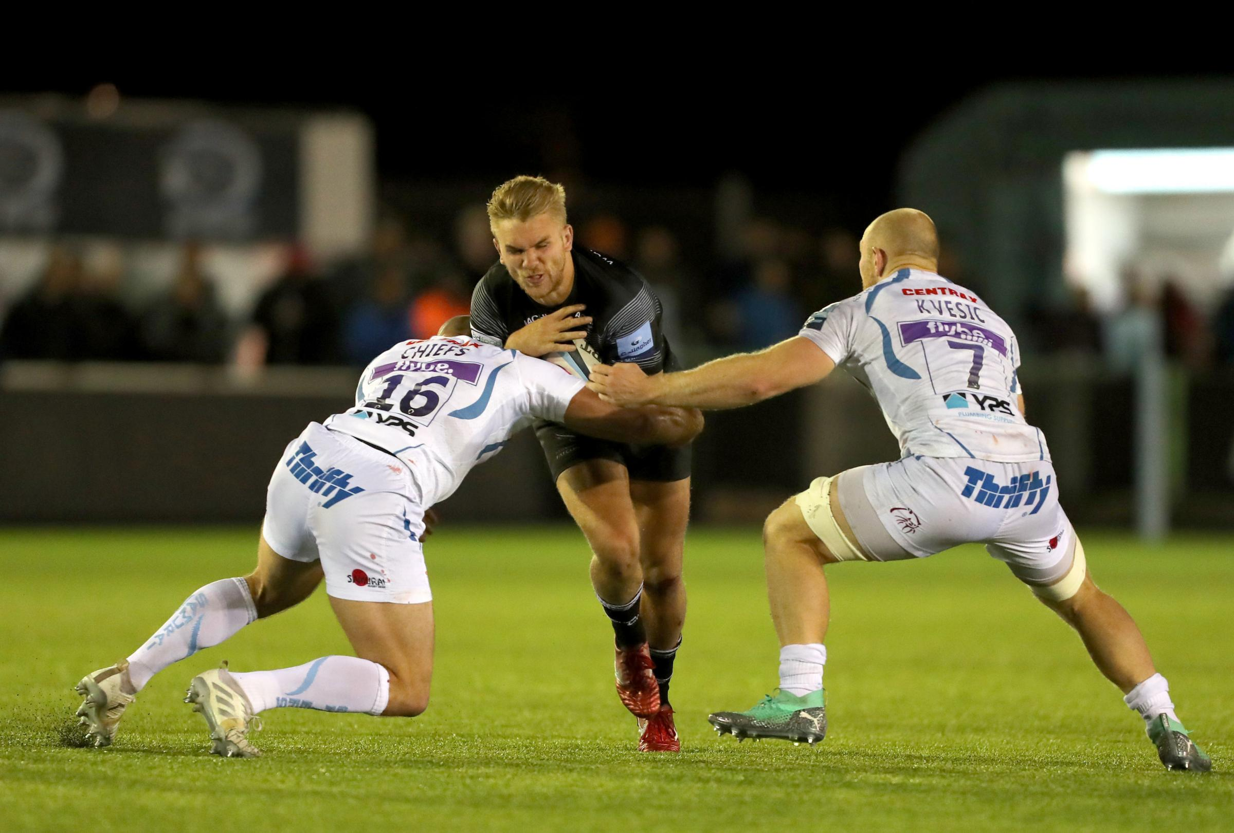 Newcastle Falcons Chris Harris (centre) is tackled by Exeter Chiefs Jack Yeandle (left) and Matt Kvesic during the Gallagher Premiership match at Kingston Park, Newcastle. PRESS ASSOCIATION Photo. Picture date: Friday September 21, 2018. See PA story RUGB