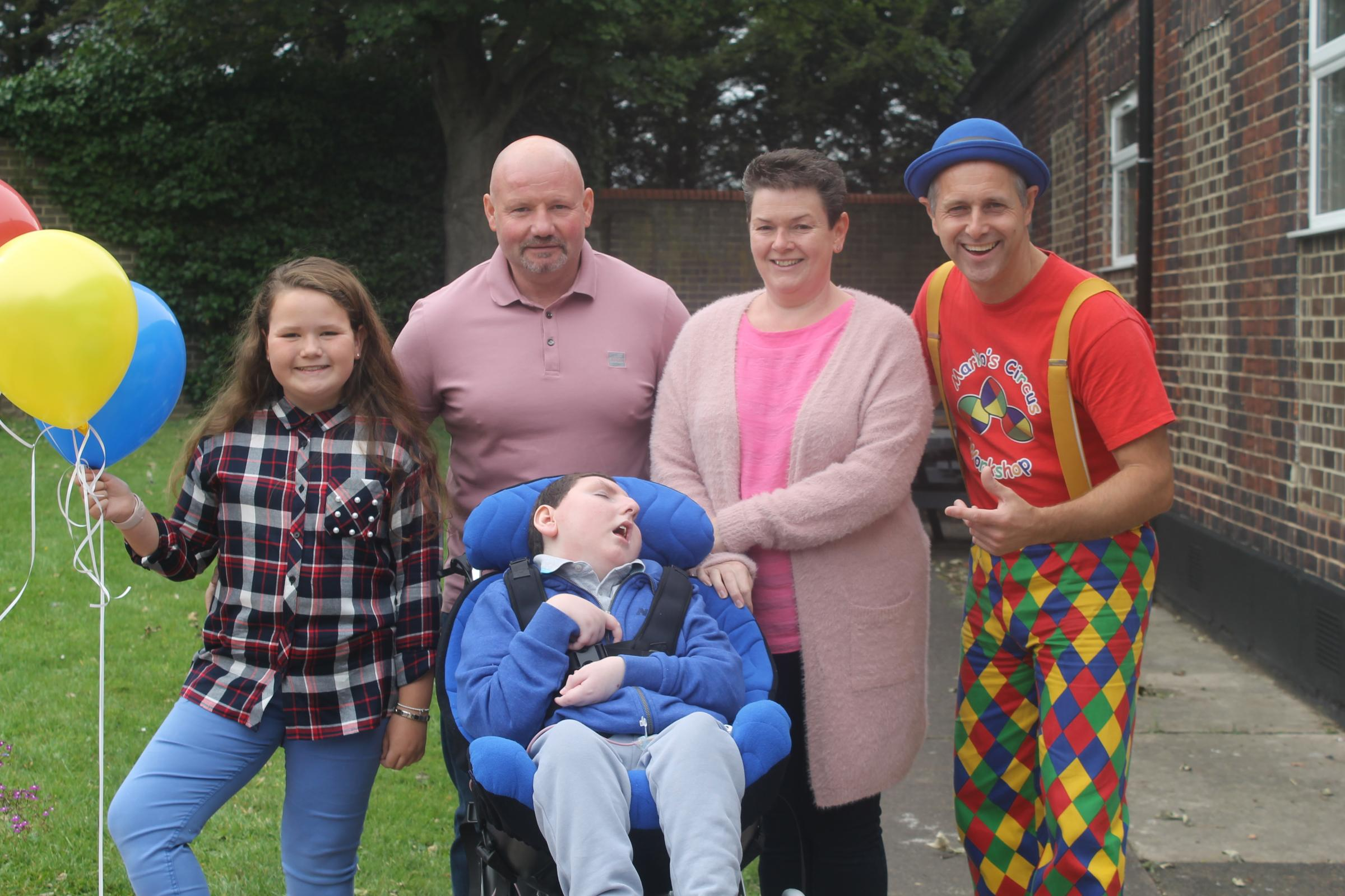 SUPPORT: Reece Parkinson and his family, with Marko, the clown. Pictures: Peter Barron