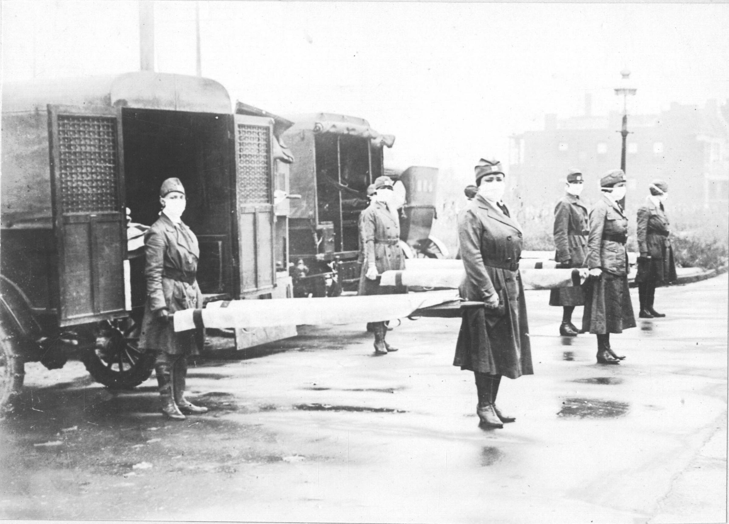 Programme Name: The Flu That Killed 50 Million - TX: n/a - Episode: The Flu That Killed 50 Million (No. n/a) - Picture Shows: Ambulance and nurses