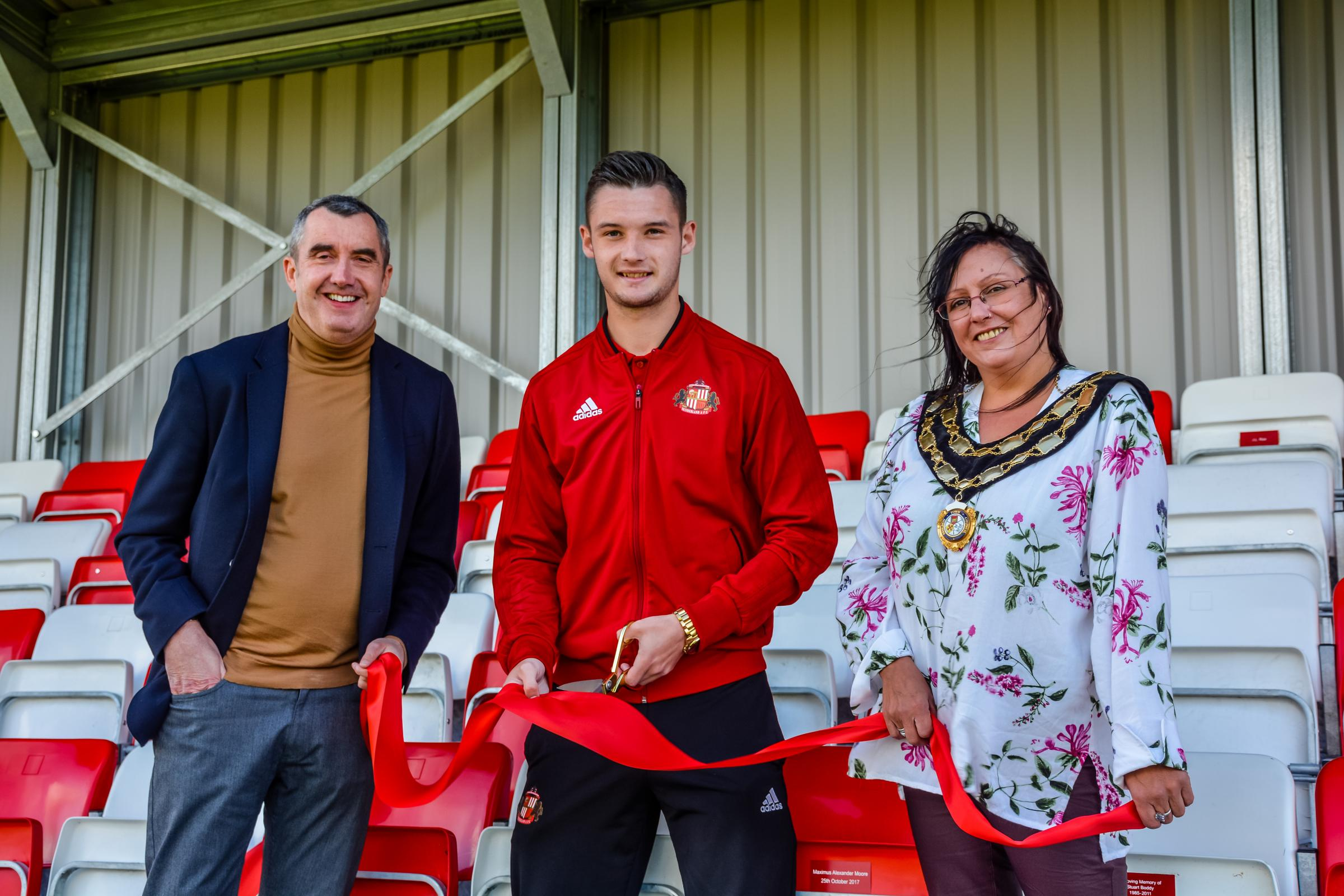 OPEN: Luke Molyneux opens the new stand alongside Shildon AFC Chairman, David Dent and Councillor Luan Deakin.