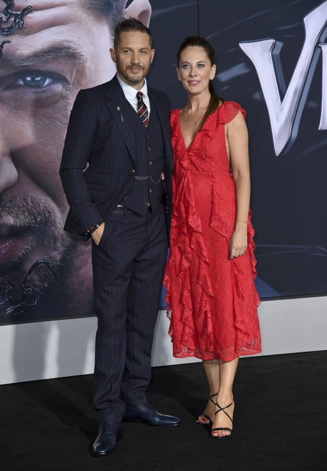 Actor Tom Hardy, left, and writer Kelly Marcel arrive at the world premiere of