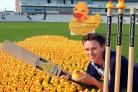 DUCK RUNNING: Durham County cricketer Gary Pratt in a sea of ducks at the Durham ground to launch the Grand Durham Duck race