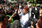 File photo dated 06/05/2011 of Anjem Choudary (centre) who is facing jail after he was convicted at the Old Bailey of drumming up support for the Islamic State terror group. PRESS ASSOCIATION Photo. Issue date: Tuesday August 16, 2016. The 49-year-old Mus