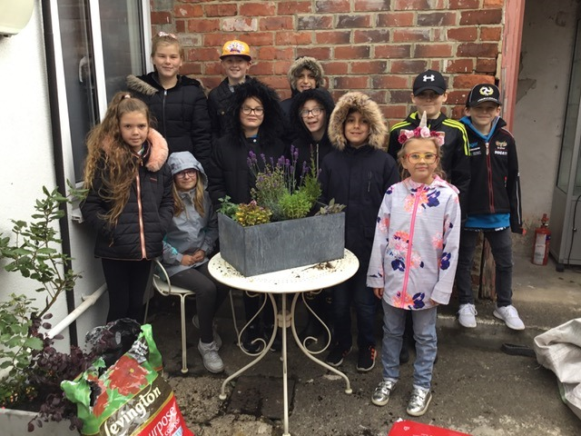 GROW: Children from St Hild's School, in Gilesgate, who helped create a sensory garden at Simon Berry Opticians