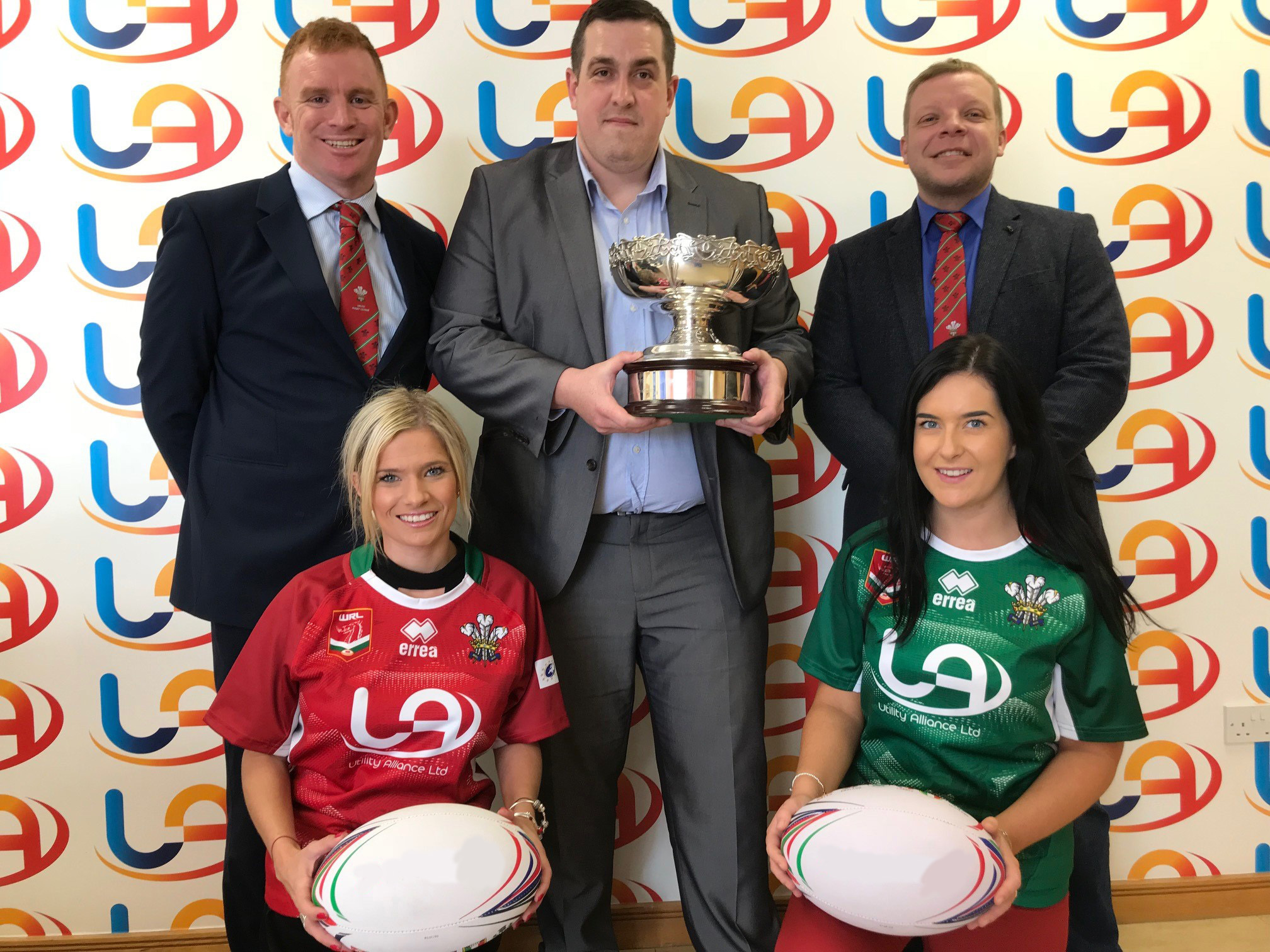 TEAM COLOURS: Front, Vicky Boynton and Sadie Wise with, middle, Tim Strange, of Utility Alliance, Craig Poskitt of the Welsh Rugby League, right, and Chris Thair, of the rugby league